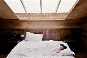 Woman_Sleeping_In_Bed